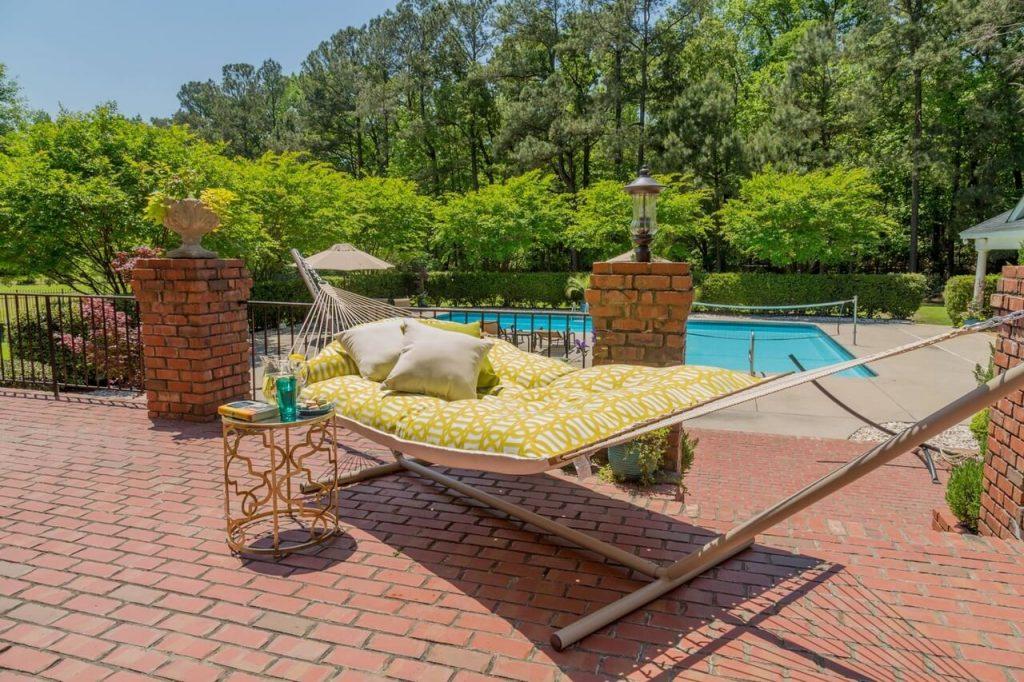tufted hammock by pool